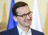 """Marek Suski zabrał tablicę przedstawiającą """"układ Kaczyńskiego"""". Sprawę skomentował premier"""