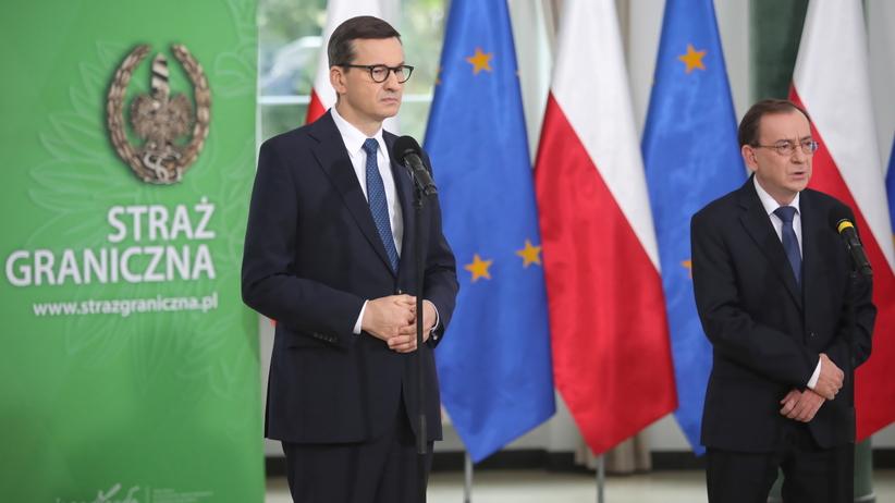 premier Mateusz Morawiecki, szef MSWiA Mariusz Kamiński i komendant główny SG Tomasz Praga